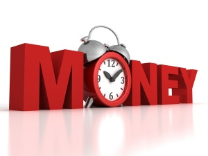 Time is money concept with red alarm clock